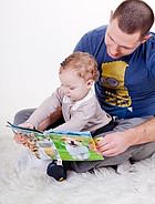 Father teaching his child how to read